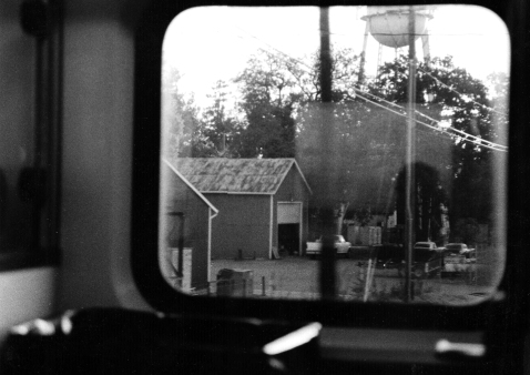 Passing through small towns, Amtrak (35mm, used a split filter during printing, spots you see are from the scan not the print)