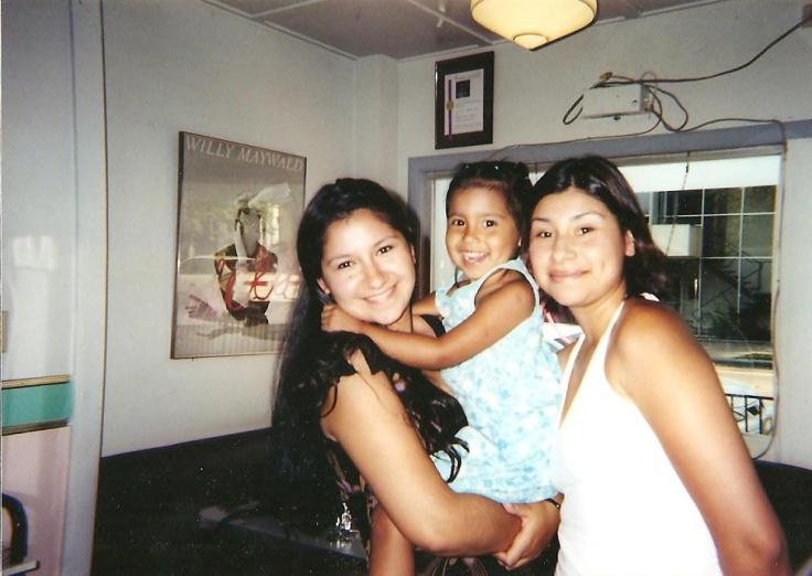 circa 2003, my graduation day. me, my neice, & my sister